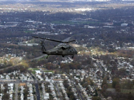 A New Jersey National Guard Blackhawk helicopter flies
