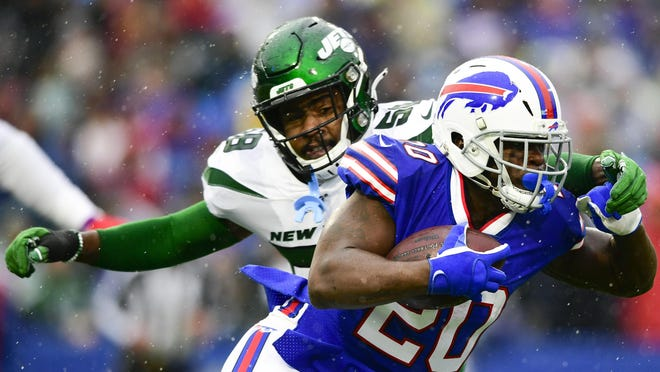 Buffalo Bills running back Frank Gore runs past Jets outside linebacker James Burgess during the first half of a Dec. 29, 2019, game in Orchard Park, N.Y. Gore, entering his 16th season, and Burgess are now teammates.