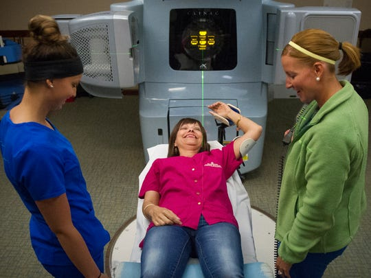 Rebecca Southard, of Owensville, prepares for her final radiation treatment for breast caners with radiation therapists, Kaitlyn Duncan, of Evansville, left, and Lauren Simpson, of Henderson, right, at Deaconess Gateway Hospital in Newburgh, Thursday, Sept. 23, 2016.