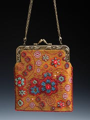 """""""Flower Power"""" handbag by Deb Rades, who is taking part in the second Door County Wearable Art Show of the season."""