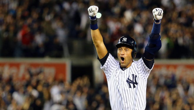 Derek Jeter celebrates after a game winning RBI hit in the ninth inning against the Baltimore Orioles in his last game ever at Yankee Stadium on Thursday.