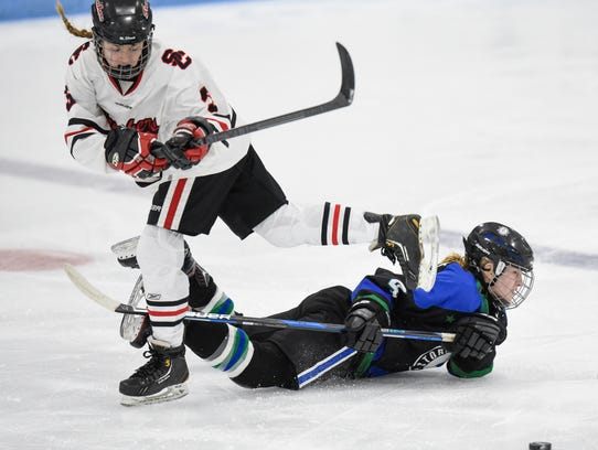 Players struggle for control of the puck during the
