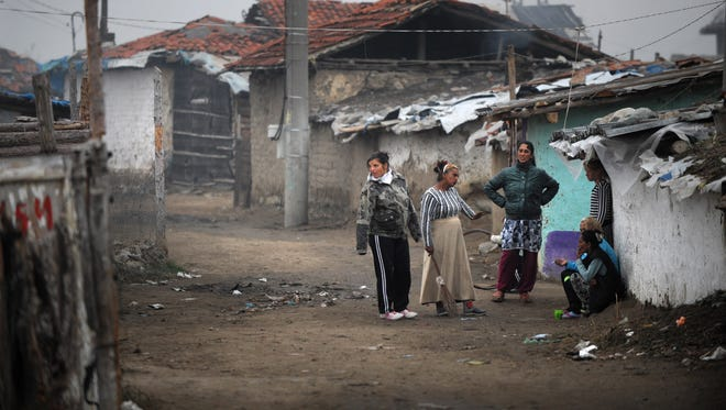 Bulgarian Roma people in the Roma district of the central Bulgarian town of Nikolaevo.