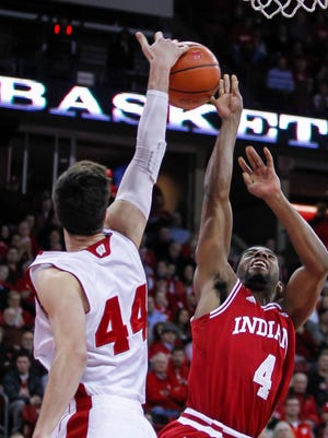 Wisconsin's Frank Kaminsky (44) bats away a shoot by Indiana's Robert Johnson during the first half of an NCAA college basketball game Tuesday, Feb. 3, 2015, in Madison, Wis.