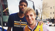 NBA All-Star Paul George poses with Ben Erickson after