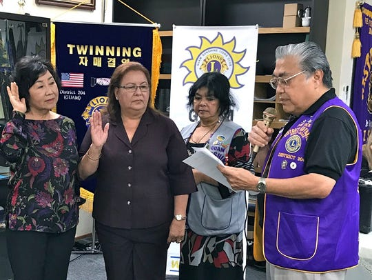 The Guam Sunshine Lions Club inducted two new members,