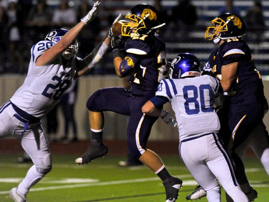 Wylie tailback Bailey Hicks successfully catches a pass during Friday's game against Decatur in Graham. Though the Bulldogs led 14-0 early, Decatur came back to win the bi-district matchup, 48-34.