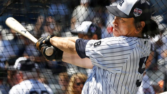 New York Yankees World Series MVP Hideki Matsui warms up in the batting cage before the Yankees annual Old Timers Day baseball game, Sunday, June 12, 2016, in New York. (AP Photo/Kathy Willens)