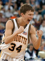 Marquette guard Travis Diener reacts after sinking