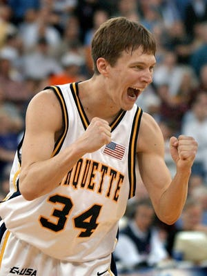 Marquette guard Travis Diener reacts after sinking a free throw that sealed the win for his team over Holy Cross during the first round of the 2003 NCAA Tournament.