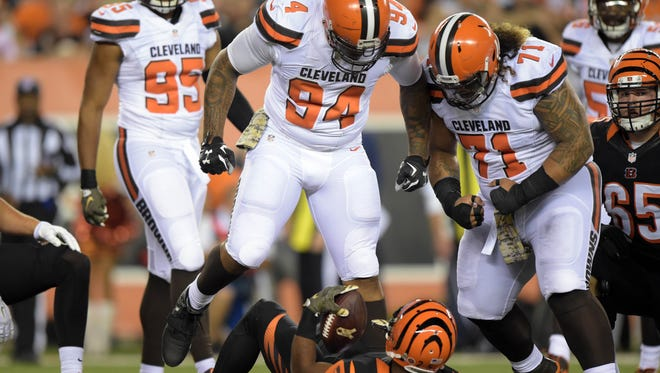 Browns defensive linemen Randy Starks (94) and Danny Shelton (71) taunt Bengals running back Giovani Bernard during a Nov. 5 game at Paul Brown Stadium.