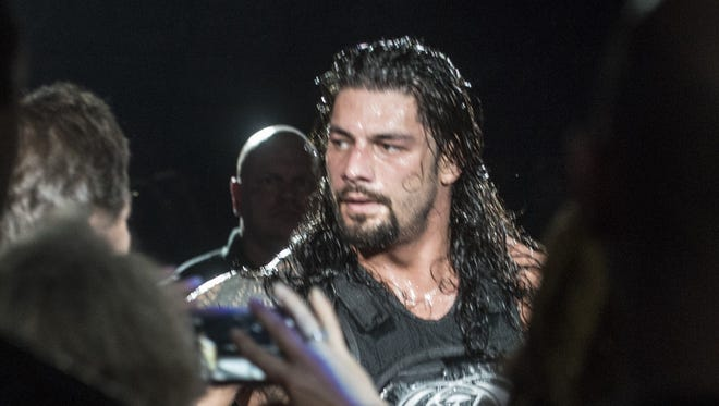 Roman Reigns greets fans after his match during a show on Jan. 9, 2016.