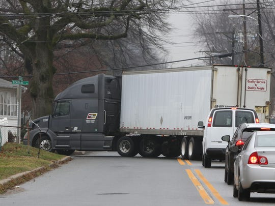 A tractor-trailer turns left onto Central Avenue off of Lambsons Lane as other vehicles wait behind it. Tractor-trailers have been using Lambsons Lane and connecting residential streets as a shortcut to Del. 9/New Castle Avenue near the Port of Wilmington.