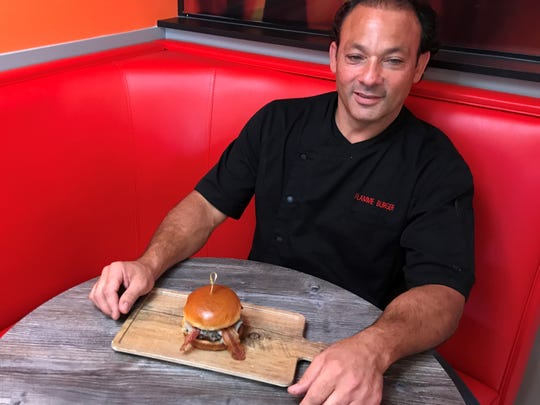 Flamme Burger owner Henri Najem's love for burgers dates to his childhood, when famous fast-food chains like Indiana's Burger Chef were popping up all over America. Growing up, the half-Lebanese Najem loved the family dish kafta, seasoned ground meat shaped around a skewer and grilled.