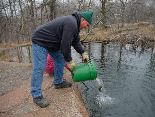 Urban fishing stocked ponds draw city dwellers newbies for Stocked fishing ponds