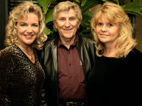 Club owner Ruble Sanderson, center, attends a 2006 event with Lisa Harless, left, and wife Brenda Sanderson.