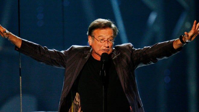 Robin Williams introduces the band Genesis during the VH1 Rock Honors convert at the Mandalay Bay hotel-casino in Las Vegas in 2007
