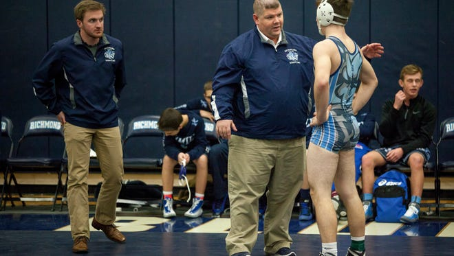 Richmond coach Brandon Day talks with Eric Barr during a BWAC wrestling meet Wednesday, Jan. 13, 2016 at Richmond High School.