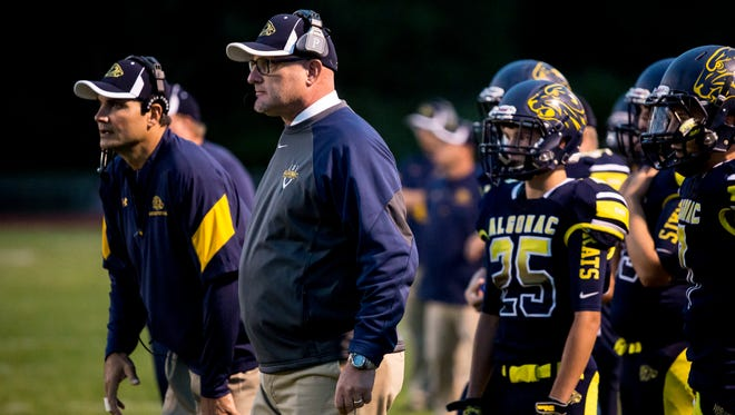 Algonac coach Scott Barnhart watches the action from the sidelines during a football game.