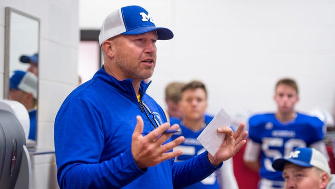 Head coach John Hurley speaks to the football team before the Memorial Tigers' game against the North Huskies at Romain Stadium in Evansville, Ind., on Friday, Sept. 1, 2017. Memorial won 41-13.