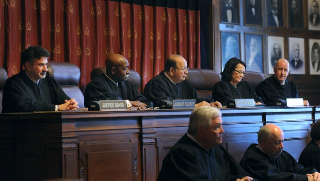 Justice Loretta Rush became the 108th Justice of the Indiana Supreme Court Friday morning at the State House. Justice Steven David, Justice Robert Rucker, Chief Justice Brent Dickson, Justice Loretta Rush and Justice Mark Massa, right.