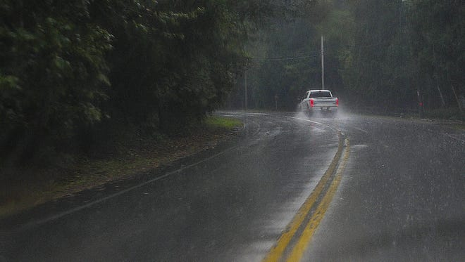 Water from a heavy rainstorm covers County G south of Egg Harbor on Thursday afternoon. The storm knocked out power to about 3,000 Wisconsin Public Service Corp. customers for a while.
