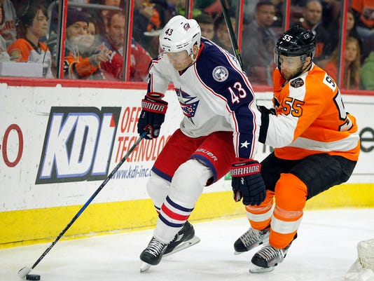 Columbus Blue Jackets' Scott Hartnell, left, controls the puck as Philadelphia Flyers' Nick Schultz pursues during the first period of an NHL hockey game, Saturday, April 8, 2017, in Philadelphia. (AP Photo/Tom Mihalek)