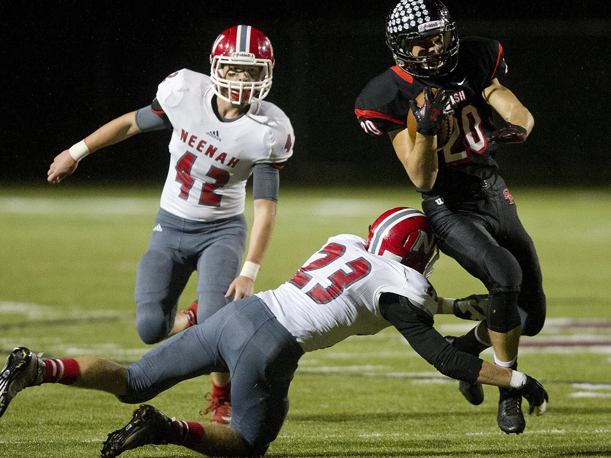 Neenah's Sam Ferron, left, watches as teammate Weston Hertel, center, tries to stop SPASH's Gus Turner Zick during the Valley Football Association football game at Goerke Field in Stevens Point on Friday, Sept. 18, 2015.