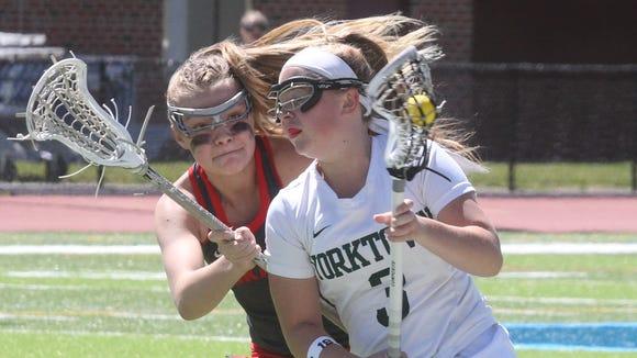 Yorktown's Michelle Seger is pressured by Niskayuna's Katherine Christian during the Class B regional lacrosse final at Suffern Middle School June 3, 2017. Yorktown won 13-3.