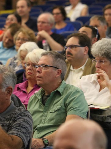 Attendees listen to candidates during the City of Poughkeepsie