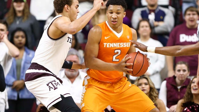 Dec 29, 2016; College Station, TX, USA; Tennessee Volunteers forward Grant Williams (2) controls the ball as Texas A&M Aggies forward DJ Hogg (1) defends during the second half at Reed Arena. Mandatory Credit: Troy Taormina-USA TODAY Sports