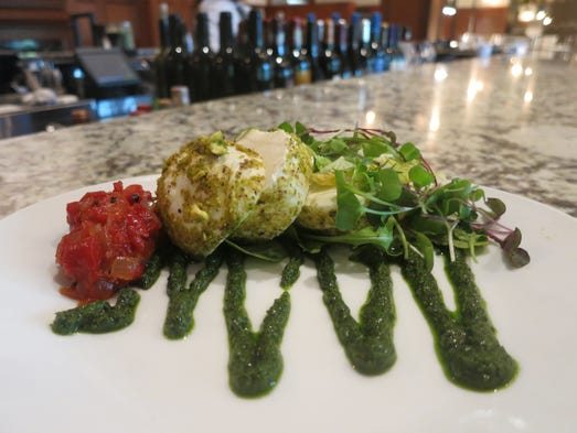A starter of pistachio-crusted mozzarella with sweet