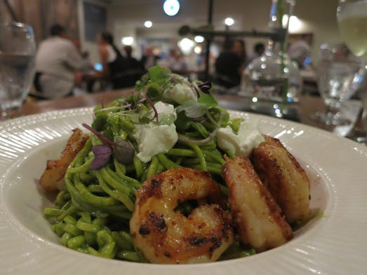 Grilled Okemos-grown shrimp are served with hand-rolled