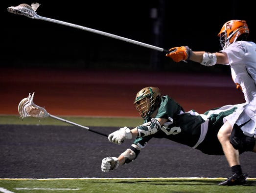 York Catholic's Eli Doyle makes a diving attempt for