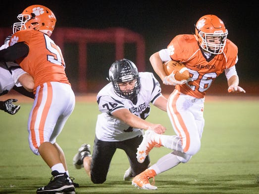 Central York's Hunter Werner (26) escapes an attempted