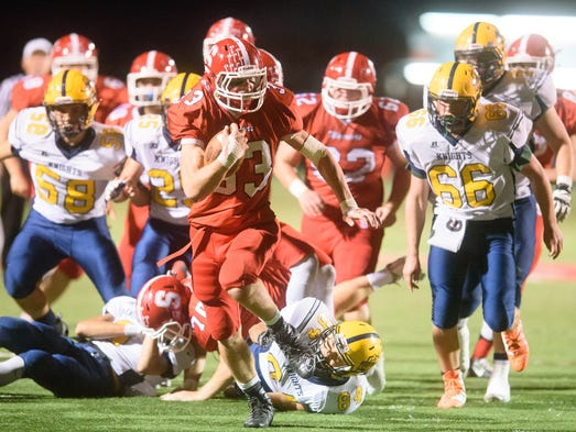 Susquehannock's Jack Allred (33) takes off on one of