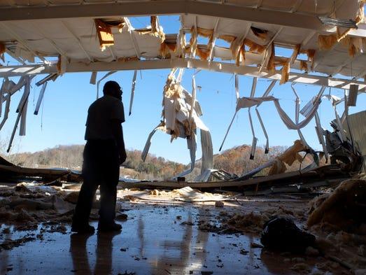 Fairview Baptist Pastor Carlos Mauricio surveys damage