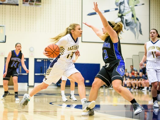 Eastern York's Hannah Myers (14) drives to the basket