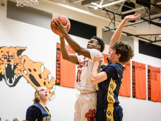 Northeastern's Fred Mulbah (11) puts up a shot against