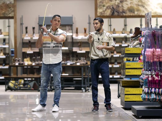 Arturo Salas, right, Cabela's fly fishing expert teaches