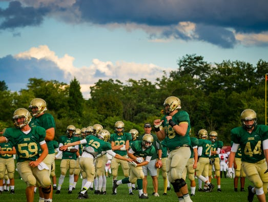 York Catholic warms up before a YAIAA game against