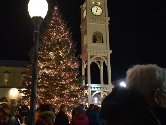 "The lighting of the city Christmas tree under the Nicolet Bank Clock Tower is part of Sturgeon Bay's ""Christmas By the Bay"" weekend."
