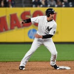 New York Yankees Jacoby Ellsbury steals second base off Boston Red Sox starting pitcher Steven Wright in the first inning of a baseball game, Friday, May 6, 2016, in New York. Ellsbury left the game after the first inning with an injury.