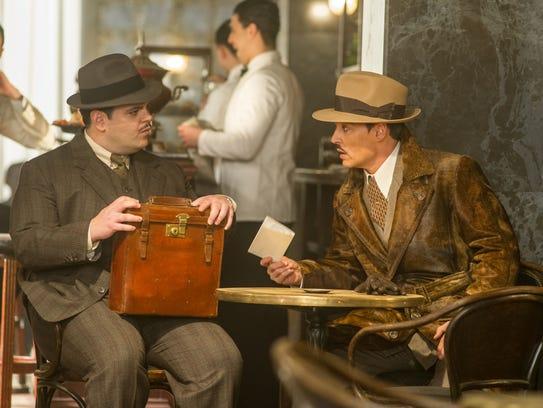 Josh Gad, left, and Johnny Depp star in 'Murder on