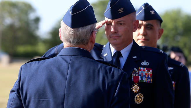 Col. Michael Downs is pinned with a medal after relinquishing command of the 17th Training Wing at Goodfellow Air Force Base during the base's change of command ceremony Friday, July, 2017.
