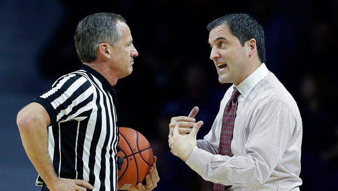 Iowa State head coach Steve Prohm, right, questions a call during the first half of an NCAA college basketball game against Kansas State, Saturday, Jan. 16, 2016, in Manhattan, Kan.