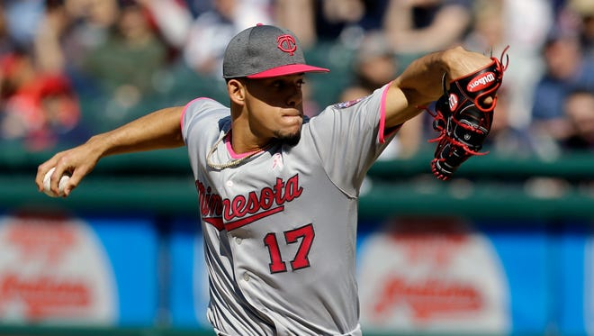 Minnesota Twins starting pitcher Jose Berrios delivers in the first inning of a baseball game against the Cleveland Indians, Saturday, May 13, 2017, in Cleveland.