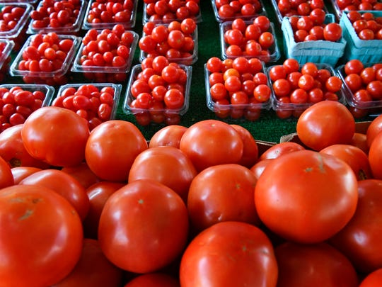 Early tomatoes are now in at the stall of Southern Roots Produce at the Nashville Farmers' Market, with more to come as the season reaches its peak.