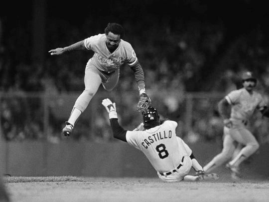 Tigers third baseman Marty Castillo steals second as he slides in safely under the Royals; Frank White in the second inning of Game 3 of the American League Championship Series on Oct. 5, 1984.