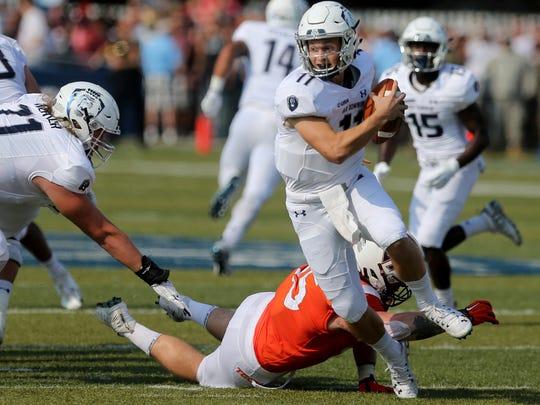 Old Dominion quarterback Blake LaRussa avoids a sack by Virginia Tech's Jerrod Hewitt during the first half of an NCAA college football game Saturday, Sept. 22, 2018, in Norfolk, Va. (AP Photo/Jason Hirschfeld)